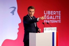 French President Emmanuel Macron delivers a speech to present his strategy to fight 'separatism', on October 2, 2020 in Les Mureaux, outside Paris [Ludovic Marin/Pool/AP]