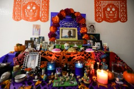 A portrait of Dr Jose Luis Linares who died from symptoms related to COVID-19, placed on a Day of the Dead altar made by his wife Rosario Martinez at their home in Mexico City. He is one of more than 1,700 Mexican health workers officially known to have died of COVID-19 who are being honoured with three days of national mourning coinciding with the Day of the Dead festival [Eduardo Verdugo/AP Photo]