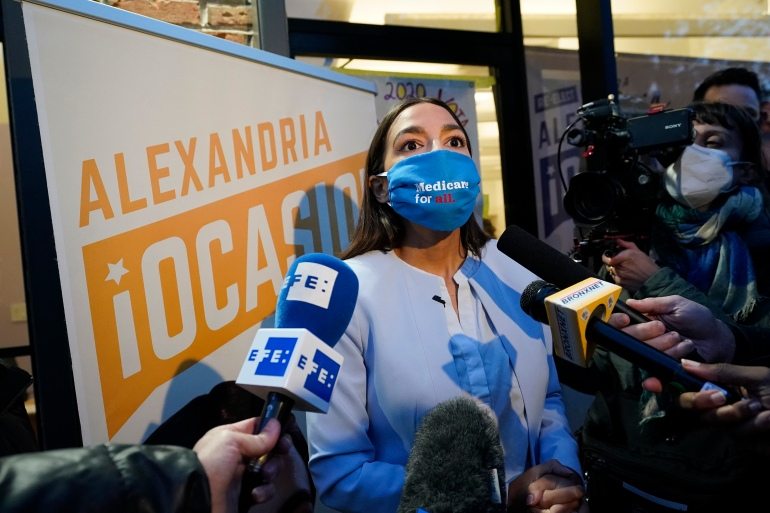 Alexandria Ocasio-Cortez, a Democrat from New York, speaks to the media after addressing members of her staff and volunteers who helped with her campaign [Kathy Willens/AP Photo]