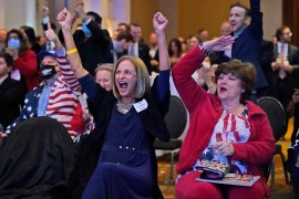Frankie Ross, center, a supporter of Republican candidate for Senate U.S. Sen. David Perdue, cheer as Fox News called Florida for President Trump during an election-night watch party Tuesday Nov. 3, 2020 in Atlanta. (AP Photo/John Bazemore)