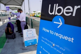 Californians voted in favour of a ballot measure exempting Uber, Lyft and other app-based delivery drivers from being classified as company employees eligible for benefits and job protections [Damian Dovarganes/AP Photo]