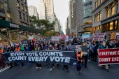 Demonstrators march down Fifth Avenue to advocate for the counting of all votes on November 4, 2020, in New York [AP/Frank Franklin II]