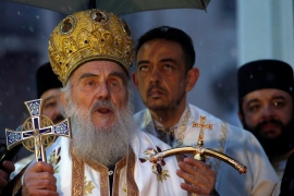 Patriarch Irinej last Sunday led the prayers at the big public funeral for the church head in Montenegro, Bishop Amfilohije, who had died after contracting the virus [File: Darko Vojinovic/AP]