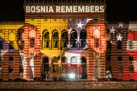 A photo of US President-elect Joe Biden and Bosnia's first President Alija Izetbegovic is projected on the National Library building in Sarajevo, Bosnia [Kemal Softic/AP]