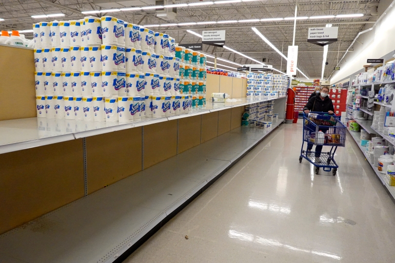 Supermarket chains are limiting how much toilet paper and paper towels shoppers can buy after demand spiked recently [File: Michael Conroy/Reuters]