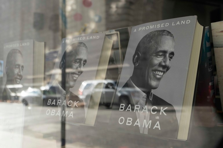 """A Promised Land"" by former President Barack Obama is displayed in the window of a New York bookstore on November 18, 2020 [AP/Mark Lennihan]"
