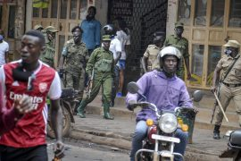 Ugandan security forces patrol on a street in Kampala [AP Photo]