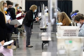 Recount observers watch ballots during a Milwaukee hand recount of presidential votes in Wisconsin [Nam Y Huh/AP]