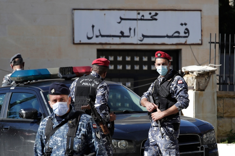Lebanese policemen stand guard outside the Baabda courthouse compound where nearly 70 inmates broke out of a prison early on Saturday after smashing their cell doors and attacking prison guards, in the Beirut southeastern suburb of Baabda, Lebanon, on Saturday, November 21, 2020 [Hassan Ammar/AFP]
