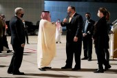 US Ambassador to Saudi Arabia John Abizaid and Saudi Arabia's Foreign Minister Faisal bin Farhan greet Secretary of State Mike Pompeo and his wife Susan as they arrive at Neom Bay Airport in Neom, Saudi Arabia on November 22, 2020 [AP/Patrick Semansky]