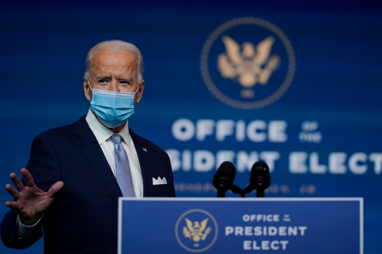 President-elect Joe Biden arrives to introduce his nominees and appointees to key posts, November 24, 2020, in Wilmington, Del [File: Carolyn Kaster/AP Photo]