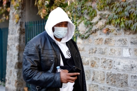 Music producer identified only by his first name, Michel, is pictured on his way to the Inspectorate General of the National Police, known by its French acronym IGPN, in Paris, Thursday, November 26, 2020 [Thibault Camus/AP Photo]