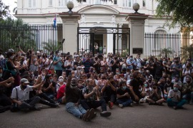 Young artists protest in front of the doors of the Ministry of Culture, in Havana, Cuba on Friday [Ismael Francisco/AP]