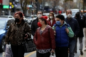 People wearing masks to help protect against the spread of coronavirus, walk, in Ankara, Turkey [Burhan Ozbilici/AP Photo]