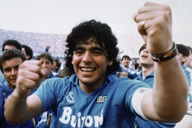 Diego Armando Maradona cheers after the Napoli team clinches its first Italian major league title in Naples on May 10, 1987 [File: Meazza Sambucetti/AP]