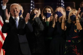 Joe Biden and his family celebrate on stage at his election rally on Saturday [Jonathan Ernst/Reuters]