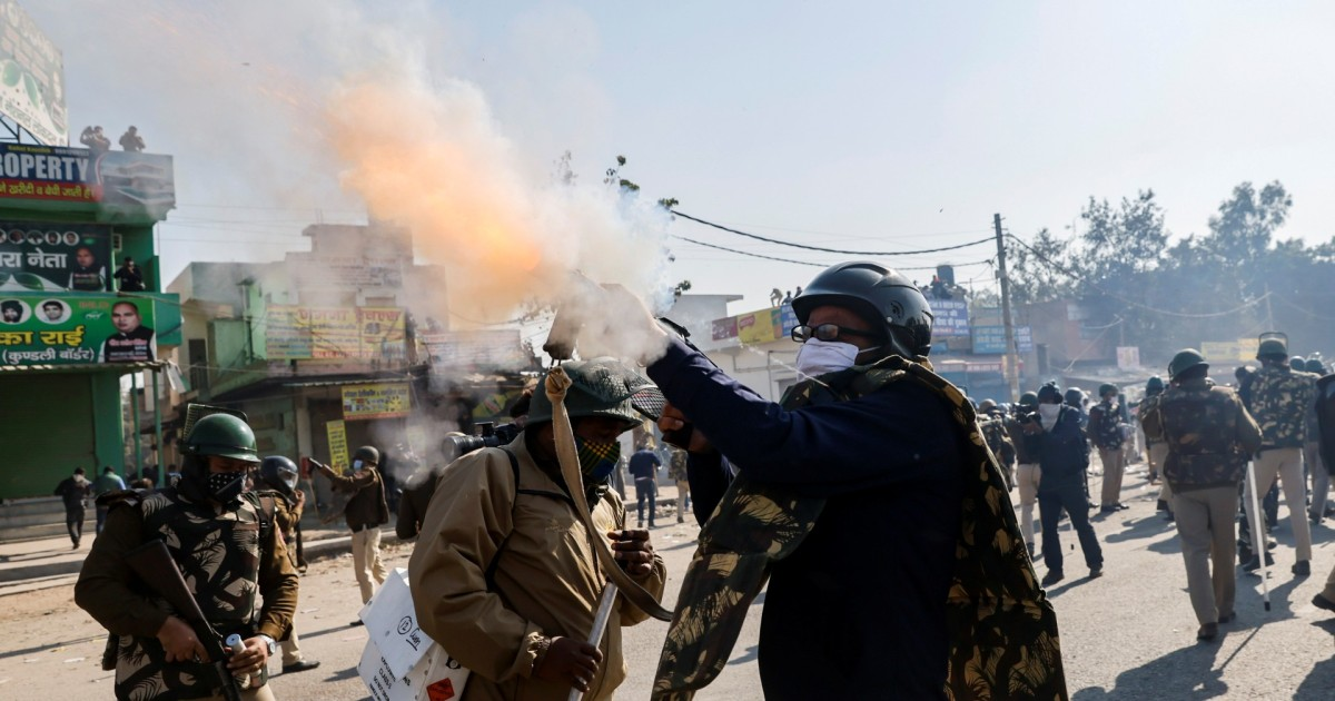 India police use tear gas, water cannon to stop farmers' march