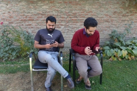 Imbesat Ahmad and Mubeen Masudi, who graduated from the prestigious Indian Institute of Technology, created two apps to circumvent the excruciatingly slow-speed internet in Kashmir [Rifat Fareed/Al Jazeera]