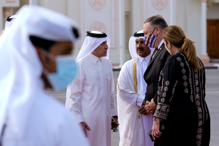 Qatar Airways CEO Akbar Al Baker, left, and Qatari Ministry of Foreign Affairs Secretary General Ahmed bin Hassan Al Hammadi greet US Secretary of State Mike Pompeo and his wife Susan as they arrive in Doha on Saturday [Patrick Semansky via AP]