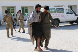 A man carries an injured person for treatment at a hospital after an attack in Khost province, Afghanistan October 27, 2020 (REUTERS/Anwarullah).