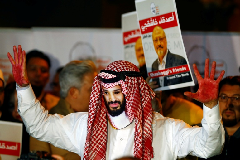 A demonstrator wearing a mask of Saudi Crown Prince Mohammed bin Salman attends a protest on October 25, 2018, outside the Saudi Arabia consulate in Istanbul, Turkey, where Saudi journalist Jamal Khashoggi was murdered [Osman Orsal/Reuters]