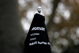 The statue for Mary Wollstonecraft by artist Maggi Hambling is seen covered with a t-shirt in Newington Green, London [Paul Childs/Reuters]