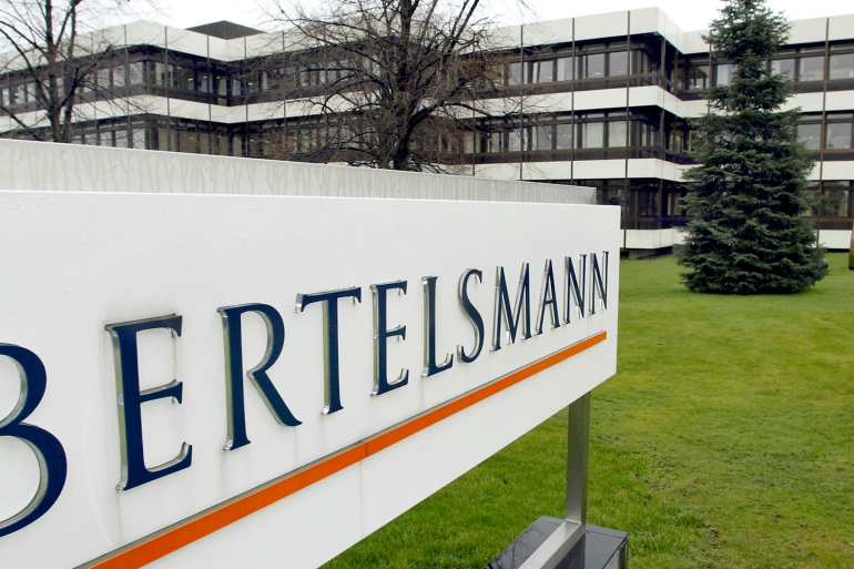 Bertelsmann, which also owns a broad portfolio of broadcast, music and online businesses, said it would buy publisher Simon & Schuster [File: Michael Sohn/AP Photo]