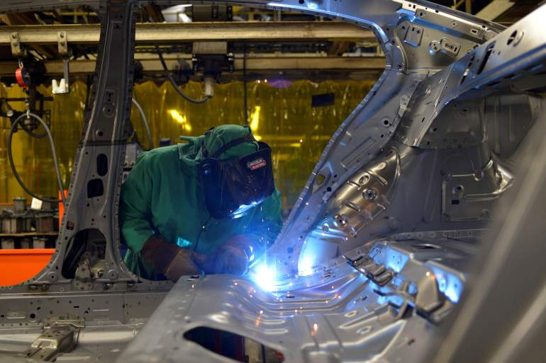 The 2020 Corporate Human Rights Benchmark found that the auto industry repeatedly failed to manage and even document human rights risks in supply chains [File: William DeShazer/Reuters]