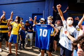 A fan holds a Diego Maradona's jersey as fans remember him in Argentina [Natalie Alcoba/Al Jazeera]