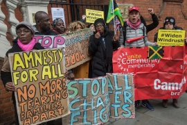 In this file image, protesters from the Movement for Justice group demonstrate outside the Jamaican High Commission in London [File: Guy Smallman/Getty Images]
