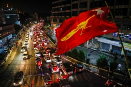 Supporters of National League for Democracy (NLD) party celebrate their party's anticipated landslide victory on the way to party headquarters in Yangon [Lynn Bo Bo/EFE]