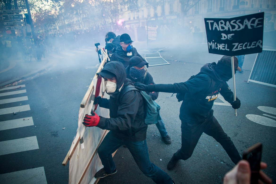 President Macron's government says the law is needed to protect police amid threats and attacks by a violent fringe. [Christophe Petit Tesson/EPA]