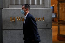 Wall Street's main indexes opened lower on Friday as rising infections overshadow positive vaccine news [File: Shannon Stapleton/Reuters]
