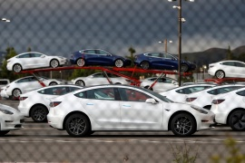 Tesla, which now commands a market capitalisation of $479bn, is expected to continue to grow as it prepares to join the S&P 500 [File: Stephen Lam/Reuters]