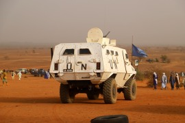 A United Nations armoured vehicle with the MINUSMA, the United Nations Multidimensional Integrated Stabilisation Mission in Mali, patrols in the desert outside Menaka [File: AFP]