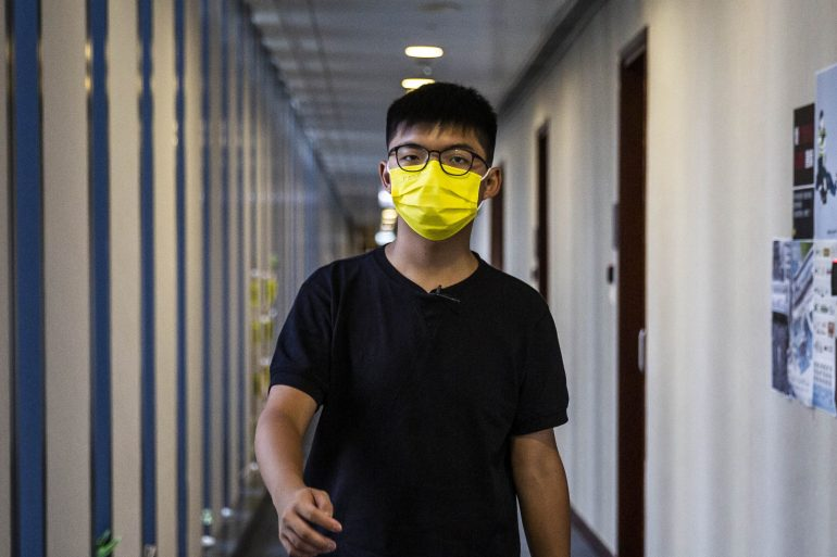 High-profile activist Joshua Wong faces as long as three years in prison when he is sentenced on Wednesday [File: Isaac Lawrence/AFP].