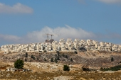 An image shows Israeli construction cranes and excavators at a building site of new housing units in the Jewish settlement of Kochav Yaakov [File: Ahmad Gharabli/AFP]