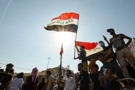 Iraqi demonstrators chant slogans during a gathering in Haboubi Square in the southern city of Nasiriya to demand an overhaul of the political system [File: Assaad al-Niyazi/AFP]