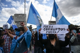 Demonstrators take part in a protest demanding the resignation of Guatemalan President Alejandro Giammattei, in Guatemala City on November 28, 2020 [Photo by Johan ORDONEZ/AFP]