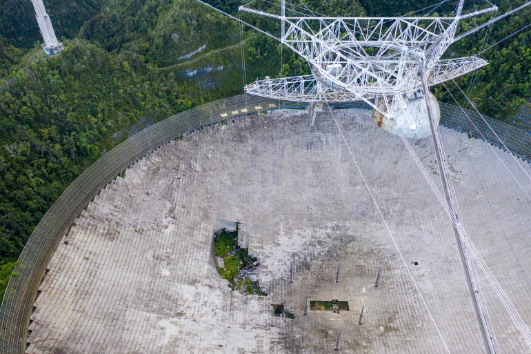 The Arecibo Observatory in Puerto Rico was closed in November 2020 after damage rendered it dangerous [File: Ricardo Arduengo/AFP]