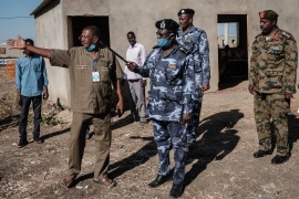 Local police and army officials inspect Village Eight transit centre, which hosts Ethiopian refugees who fled the Tigray conflict, near the Ethiopian border in Gedaref, eastern Sudan [File: Yasuyoshi Chiba/AFP]
