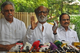 Indian actor Rajinikanth, centre, who has had several health scares, said his recent worries had been a 'warning from God' [File: AFP]