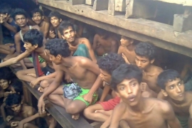 This video grab taken on December 4, 2020 from an AFPTV video shows Rohingya refugees in a boat in Chakmarkul on August 26, 2020 [AFP]