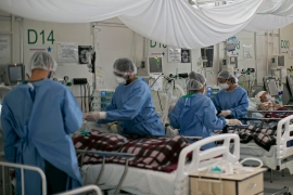 Medical workers assist COVID-19 patients at a field hospital in Belem, Para state, Brazil on December 3, 2020 [File: Tarso Sarraf/AFP]