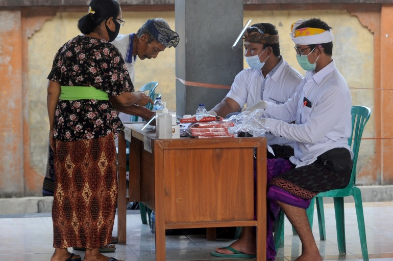 More than 100 million Indonesians are eligible to vote in Wednesday's election [Sonny Tumbelaka/AFP]