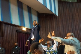 DR Congo MPs celebrate as legislators remove the assembly's speaker, in the latest round of a bitter dispute between the current president and supporters of his predecessor [Arsene Mpiana/AFP]
