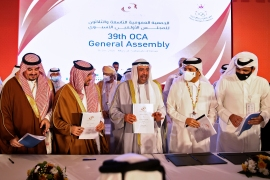 Delegates at the 39th Olympic Council of Asia (OCA) General Assembly Meeting in the Omani capital Muscat after Doha was selected as host city for 2030 Asian Games [Haitham Al-Shukairi/AFP]
