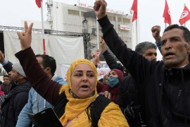 Tunisians chant slogans as they gather at Mohamed Bouazizi Square in the central Tunisian town of Sidi Bouzid on December 17, 2020, during commemorations of the 10th anniversary of Bouazizi's self-immolation [Fethi Belaid/AFP]