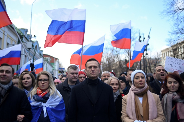 In this file photo taken on February 29, 2020, Russian opposition leader Alexei Navalny, his wife Yulia, opposition politician Lyubov Sobol and other demonstrators march in memory of murdered Kremlin critic Boris Nemtsov in downtown Moscow [File: Kirill Kudryavtsev/AFP]