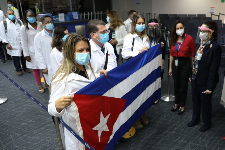 Cuban medical personnel arrive at Tocumen International Airport in Panama City, on December 24 [Aeropuerto Tocumen/AFP]